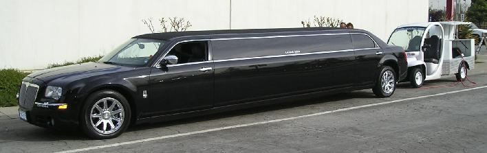 Photo of stretch limousine and Wheel Magic, Inc. mobile wheel repair wagon while technician performing wheel repair in San Jose